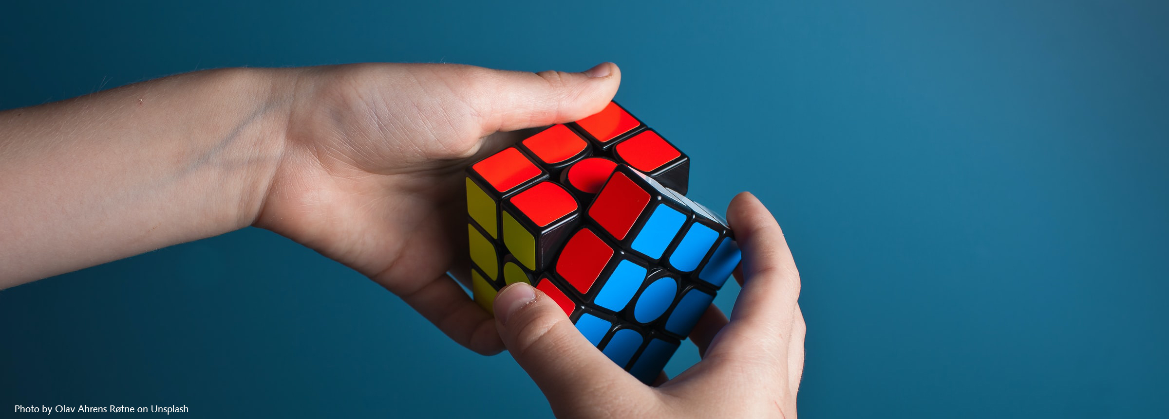 person playing magic rubiks cube